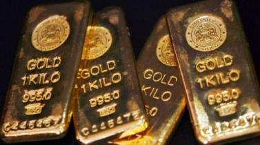 Depreciación del dólar deja al oro encaminado a mayor alza semanal en dos meses